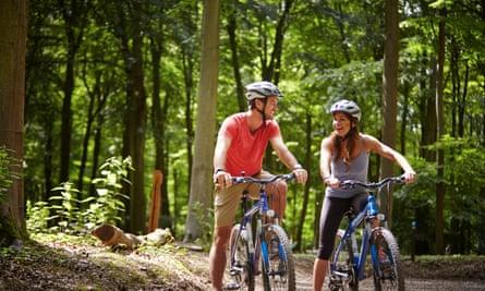 Couple cycling at Blackwood, Hampshire