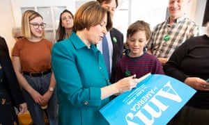 Amy Klobuchar autographs a campaign placard following a 'meet and greet' at the Waterhouse Resturant in Peterborough, New Hampshire, last month.