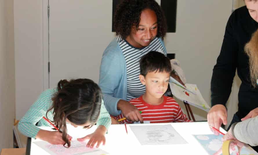 Drawing on the light box at the Guardian cartoon and art family day