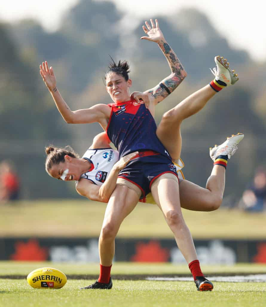 Runner up in the professional category. Angela Foley of the Crows tackles Tegan Cunningham of the Demons during the Round 7 AFLW match between the Melbourne Demons and the Adelaide Crows at Casey Fields in Melbourne.