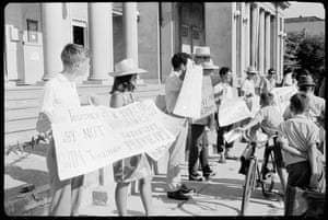 Student with placards outside outside Moree town hall and council chambers.
