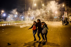 Lima, Peru Demonstrators flee from tear gas during a protest against the new government of interim president, Manuel Merino, following the impeachment and removal of former president Martin Vizcarra, at San Martin square
