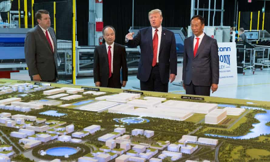 Trump with Son (second from left) and Foxconn chairman Terry Gou in Wisconsin in June.
