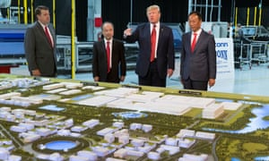 President Trump, Softbank CEO Masayoshi Son (second from left) and Foxconn chairman Terry Gou examine a model of the vast Foxconn site.