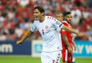 Denmark's Robert Skov celebrates after notching his first international goal.
