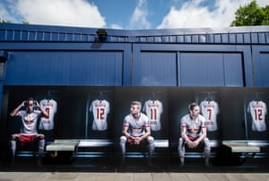 A mural shows Leipzig players Yussuf Poulsen, Timo Werner and Marcel Sabitzer on a wall of the club shop