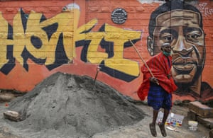 Nairobi, Kenya Direct nobility and simple eloquence characterise this work. Floyd's face has been sensitively copied from a photograph alongside one word, Haki, which means Justice, in chunky yellow and black letters. The surgical mask worn by the Maasai man in the foreground reminds us that Floyd's death has unified and awoken a planet that's been lost in the pandemic.