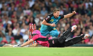 James Hopes of the Heat runs out Sean Abbott of the Sixers during the Big Bash League match at Sydney Cricket Ground.