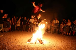 Athens, GreeceA man jumps over a fire during the annual Klidonas event that takes place on the feast of Saint John the Baptist
