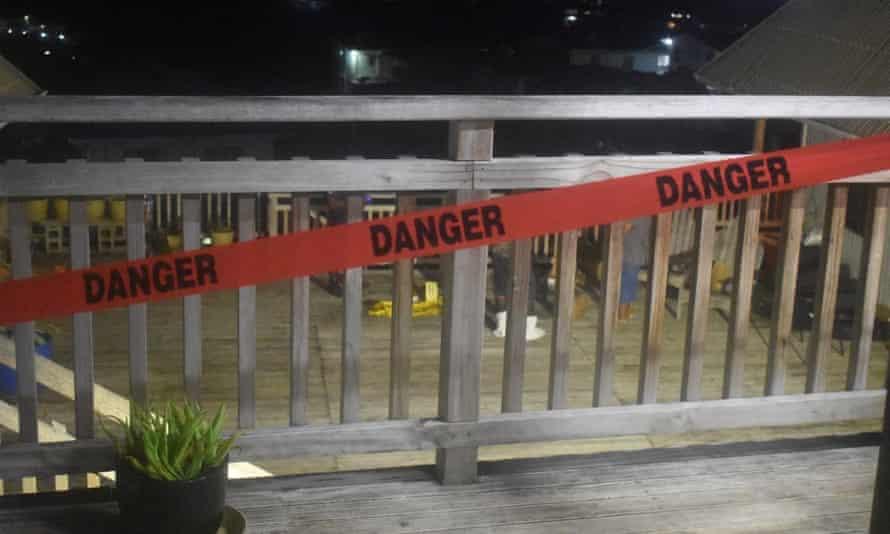Police investigators on the scene in Tasahe, Honiara, Solomon Islands, following an explosion that killed two men.