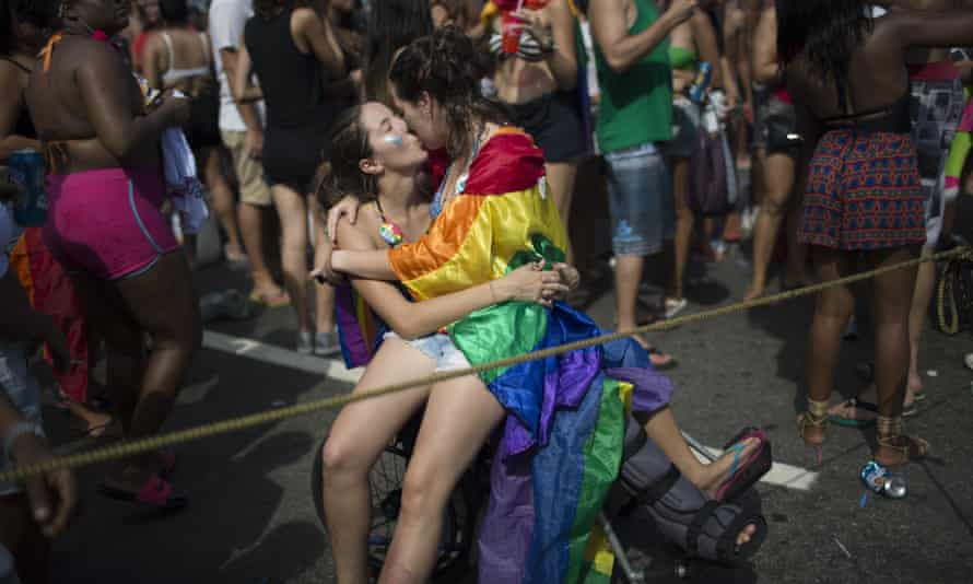Two women kiss during the gay pride parade in Rio de Janeiro, Brazil, in 2016.