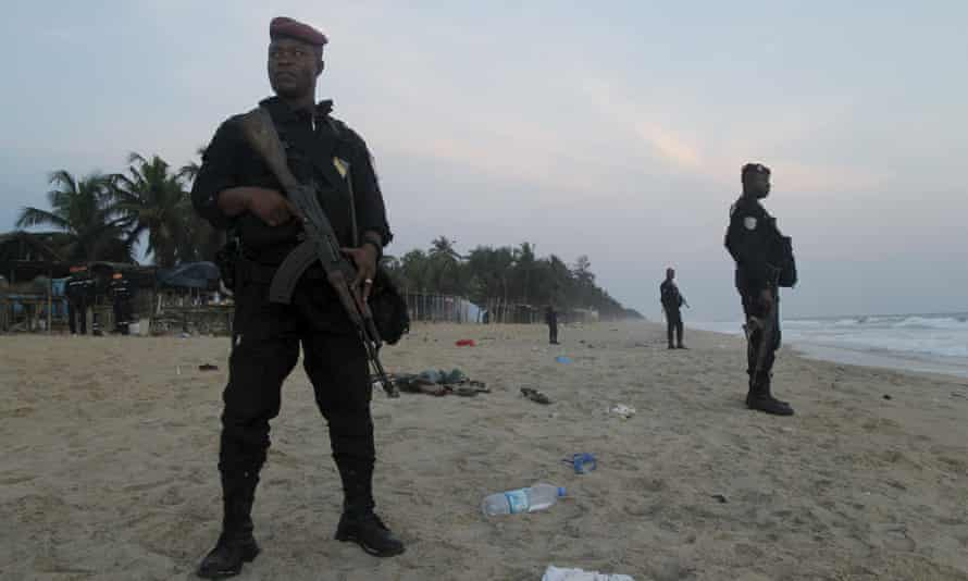 Soldiers stand in guard on the beach in Grand Bassam.