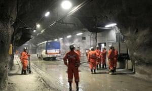 Miners wait for transport inside the Codelco El Teniente copper mine