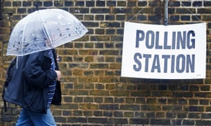 A man arrives to vote in the EU referendum in London.