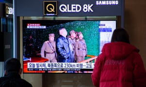 People watch breaking news of North Korea's latest projectile launch, on a TV screen at Seoul Station in Seoul