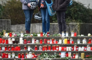 Students stand by candles placed in front of the Joseph Koenig School before school starts in Haltern am See, Germany