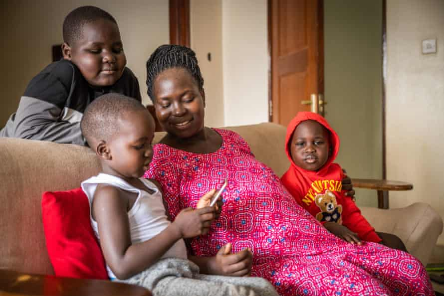 Gloria Soma with her children in Kampala