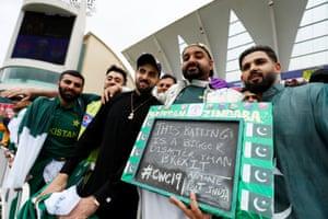 Pakistan fans pose for a photograph .