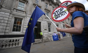 A pro-EU campaigner stands outside the Cabinet Office in London, 6 August 2019