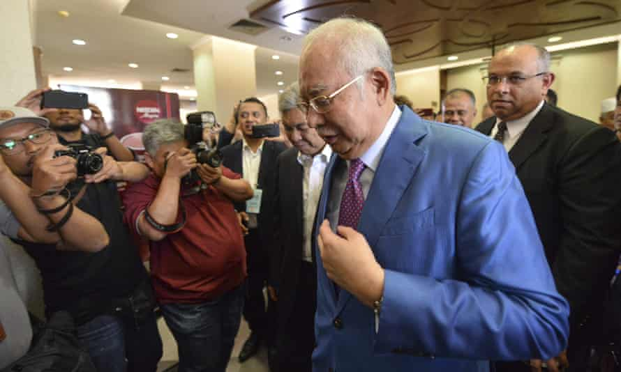 Malaysia's former prime minister Najib Razak walks out of court in Kuala Lumpur after defending himself against corruption charges linked to the country's 1MDB infrastructure fund.