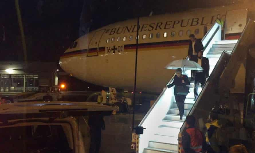 Angela Merkel disembarks at Cologne's airport after an emergency landing.