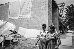 Two women walk past the area of the Gaston Motel that was dynamited by white supremacists on 11 May 1963. The motel catered specifically to African Americans and Martin Luther King had stayed in Room 30, which was used for meetings of the civil rights movement's leaders