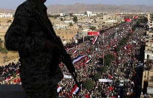 A Houthi militiaman keeps watch as Shia Muslims take part in Ashura Day celebrations in Sana'a.