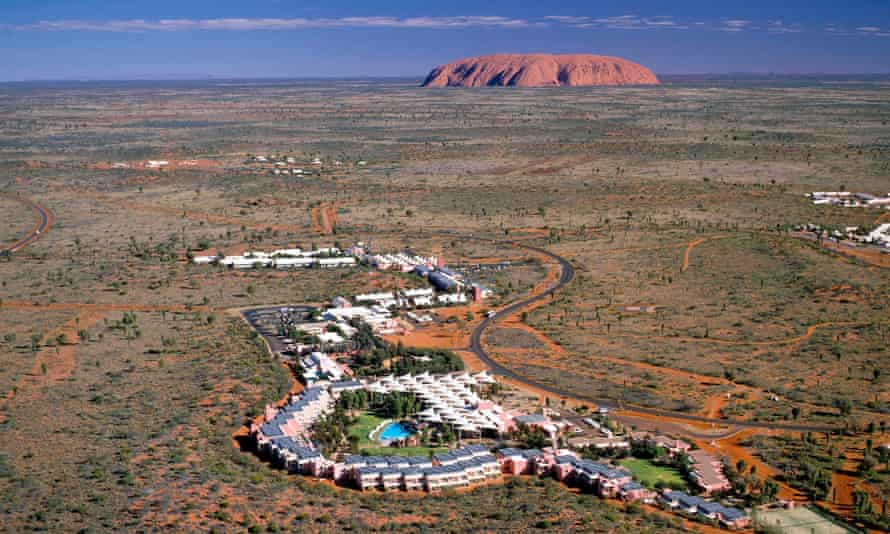 Uluru can be seen on the horizon from the grounds of Ayers Rock Resort.