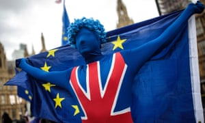 A protester outside parliament dressed in a Union flag and holding an EU flag
