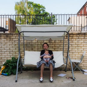 Chayelle Davidovits sits in the garden with her baby sister Gitty while waiting for the barbecue to light