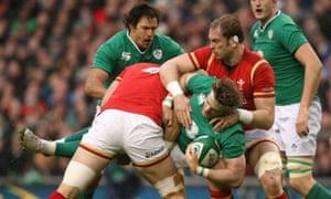 Ireland's Jamie Heaslip is tackled by Wales' Alun Wyn Jones and Luke Charteris.