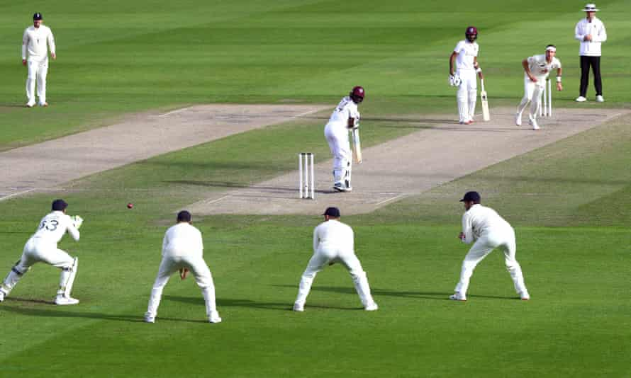 England's Jos Buttler takes a catch to dismiss West Indies' Kemar Roach off the bowling of Stuart Broad