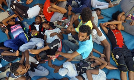 Migrants in the Ganzour shelter after being transferred due to fighting in the Libyan capital Tripoli
