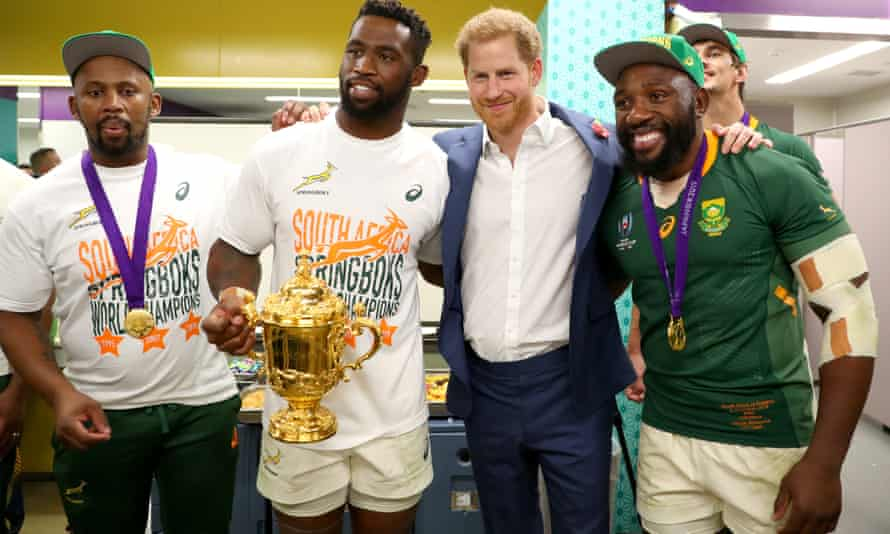 Prince Harry smiles through the pain along with England's supporters as the Webb Ellis Cup gets away again.