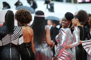Aïssa Maïga (facing camera) joins a red-carpet protest of BME female actors, against racism in French film.