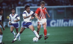Andreas Ogris takes on Marcelo Balboa.