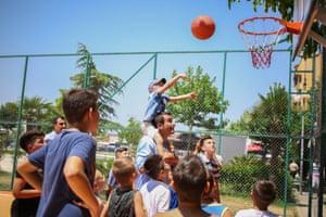 Erion Veliaj, Tirana's mayor, playing basketball with local kids.