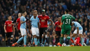 Paul Pogba clashes with Fernandinho.