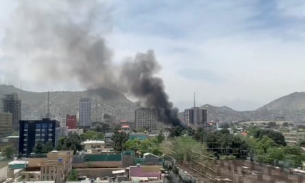 Smoke rises from an explosion in Kabul during the attack on Counterpart International's Afghan headquarters