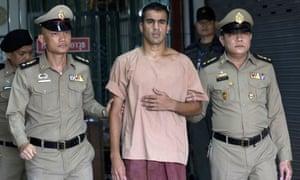 Hakeem al-Araibi leaves a Bangkok court after prosecutors said they were no longer seeking his extradition to Bahrain.