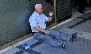 Giorgos Chatzifotiadis weeps outside a national bank branch in Thessaloniki on 3 July.