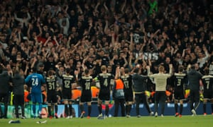 Ajax players celebrate with their fans after the final whistle.