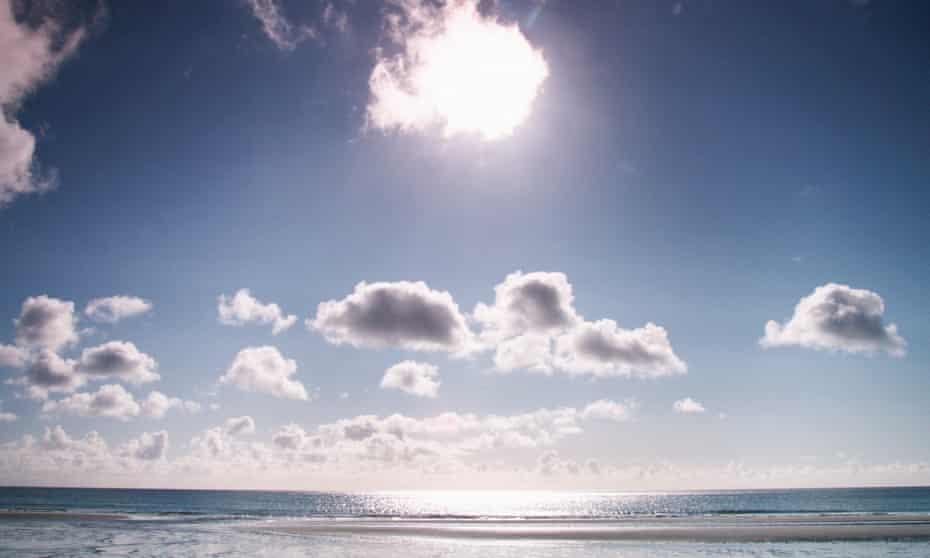 Sun shining over the sea.