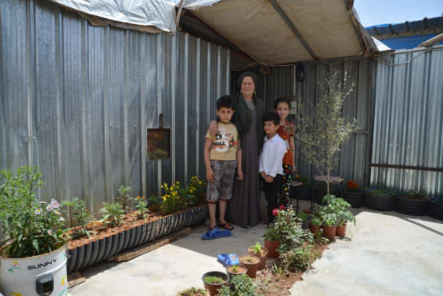 Naama Ibrahim and her children in their garden at Domiz refugee camp in Iraq.