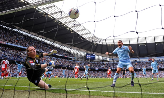 Pablo Zabalate wheels away in delight as his team-mates celebrate his opening goal in the 3-2 win over QPR which secured Manchester City's first Premier League title in 2012.