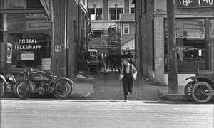 Buster Keaton runs out from the alley on to Cahuenga Boulevard in the 1922 film Cops.