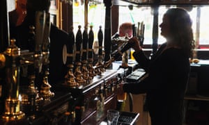 A barmaid pulls a pint in a pub. Bar staff could also be helping drinkers take more care of their health better, according to the RSPH report.