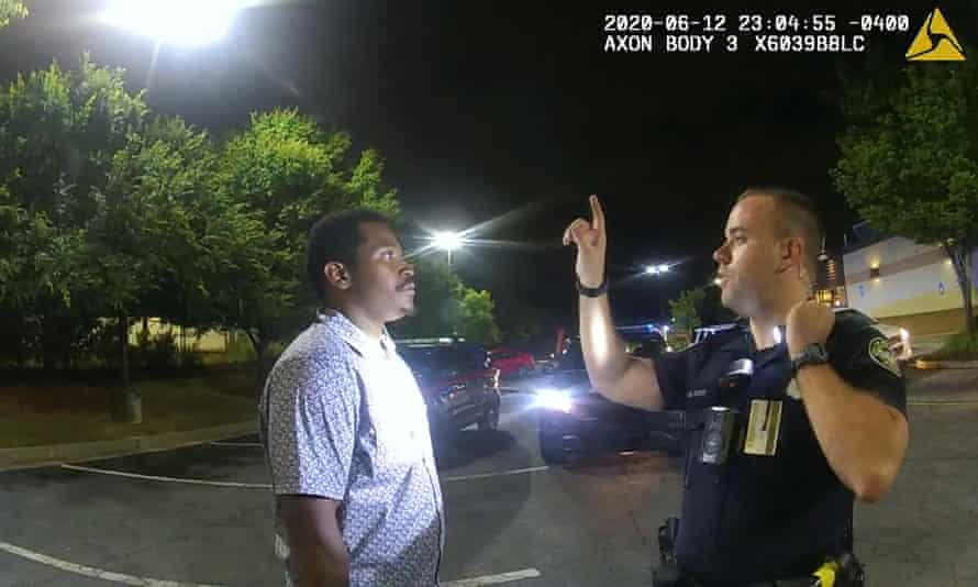 Garrett Rolfe conducts a sobriety test on Rayshard Brooks. Rolfe was on Wednesday charged with felony murder.
