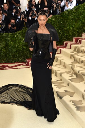 Bella Hadid went for fallen angel with her all-black Chrome Hearts outfit, complete with latex bodice, long-sweeping skirt and bolero jacket. The 21-year-old model is practically a veteran of the Met Gala; this year marks her fourth invitation.
