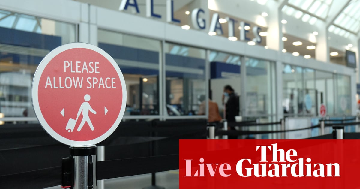 US to relax travel ban, allowing fully vaccinated passengers from UK and EU to enter country – live